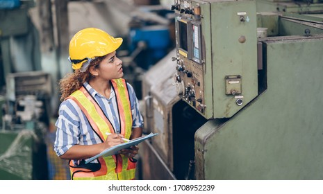 technician engineer woman checking process on tablet to machinery in factory