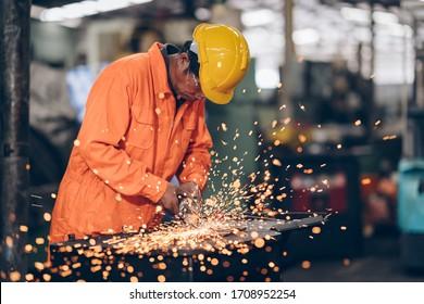 technician engineer work grinding  steel in factory