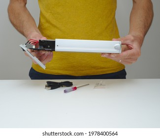 IT Technician fitting hard disk drive into external enclosure