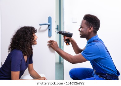 Technician Fixing The Door Lock At Clients Home