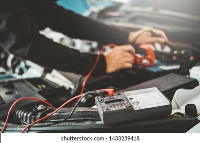 Technician Hands of car mechanic working in auto repair Service and Maintenance car battery