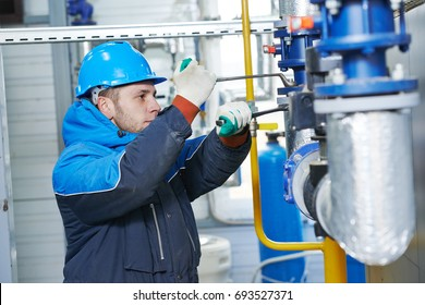 technician of heating system in boiler room