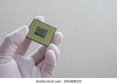 Technician holding a chipset to check quality control.