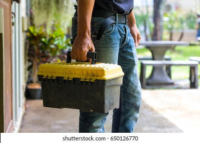technician  holding a toolbox