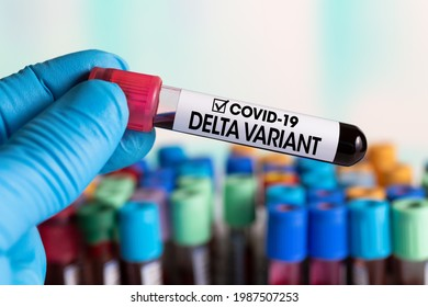 Technician holding tube of blood test identified with the label Covid-19 DELTA Variant. Doctor with a positive blood sample for the new variant detected of the coronavirus strain called DELTA