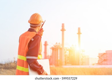 technician Industrial workers with  walkie-talkie  working in a power plant