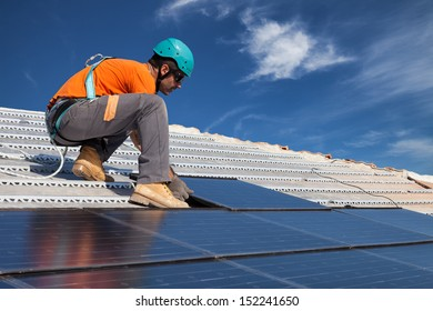 technician install new generation photovoltaic solar panels on roof