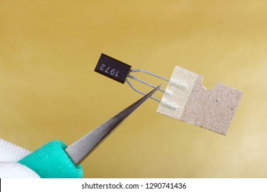 A technician install the new transistor  in modern electronic device. Masss production.  Modern technology  macro concept.