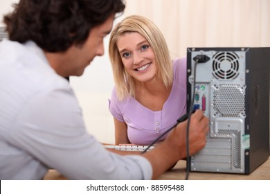 Technician installing a hard drive