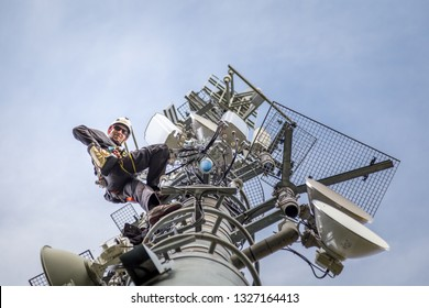 Technician is installing new antennas for fast internet