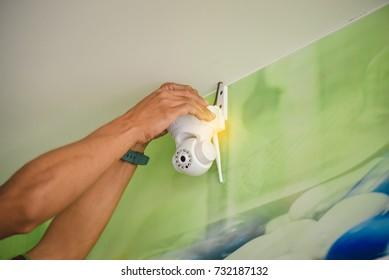 Technician installing  Robot CCTV system