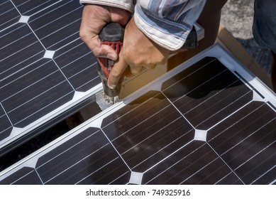 Technician installing solar cell for backup power electric.