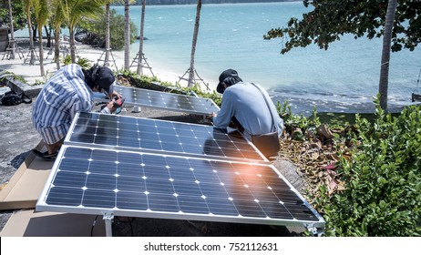 Technician is installing solar cell to save energy on the island
