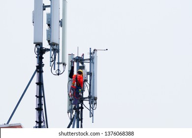 Technician maintenance on telecommunication tower doing ordinary maintenance & control to an antenna for communication, 3G, 4G and 5G cellular. Base Station or Base Transceiver Station.