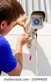 technician man setup cctv camera on wall