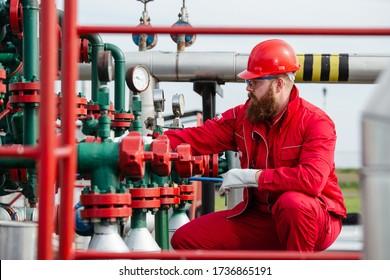 Technician in oil and gas refinery. Worker in Oil Refinery.