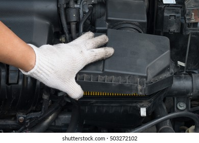Technician is opening the cover to changing new air filter for car
