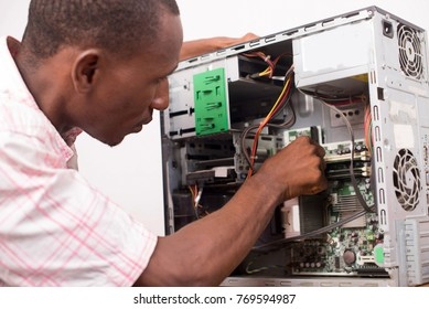 technician opens the computer hardware and verifies it.