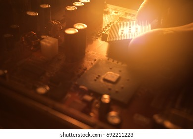 Technician plug in CPU microprocessor to motherboard socket