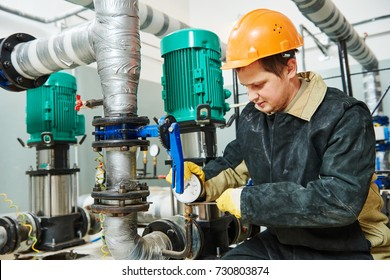 technician plumber of heating system in boiler room