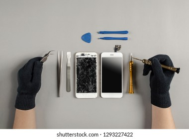 Technician prepairing to repair and replace new screen broken and cracked screen smartphone prepairing on desk