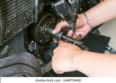 technician remove Pole Flywheel , Magnet Rotor from scooter or motorcycle with  special tools.(Flywheel Puller tool) at motorcycle garage