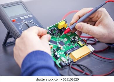 Technician repairs electronics