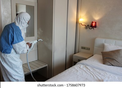 a technician is sanitizing a hotel bedroom in Prague against covid 19, using steam and ozone - Shutterstock ID 1758607973