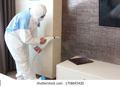 a technician is sanitizing an hotel room in Prague, using steam and ozone,  after the coronavirus SARS-CoV-2 COVID-19 pandemic - Shutterstock ID 1758692420