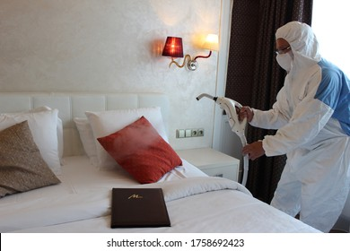 a technician is sanitizing an hotel room in Prague, using steam and ozone,  after the coronavirus SARS-CoV-2 COVID-19 pandemic - Shutterstock ID 1758692423