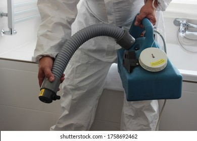 a technician is sanitizing an hotel room in Prague, using steam and ozone,  after the coronavirus SARS-CoV-2 COVID-19 pandemic - Shutterstock ID 1758692462