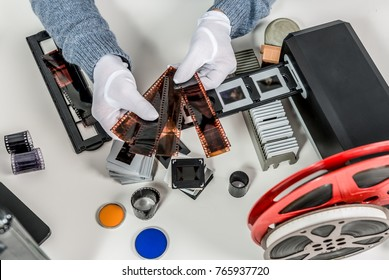 a technician scan a negative film and slides