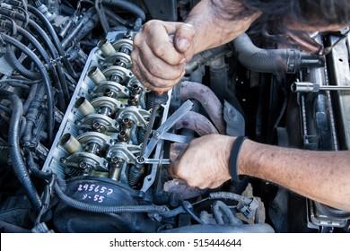 Technician service tuning engine's valve