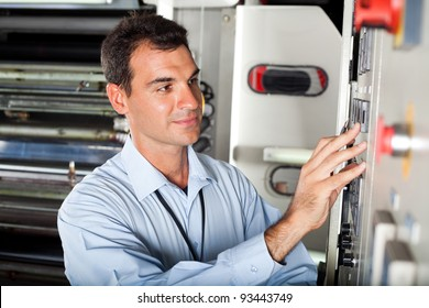 technician setting industrial machine in modern factory