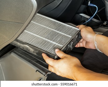 Technician take-off dirty air filter for change