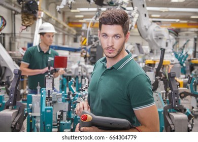 technician team while robot maintenance in a welding shop of a car manufacture