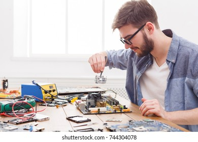 Technician upgrade of computer close up. Repairman renovate microchip component in motherboard. Maintenance support and repairing service concept.