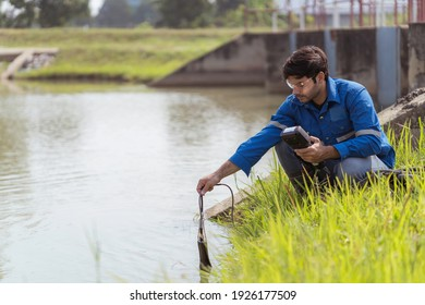 A technician use the Professional Water Testing equipment to measure the water quality at the public canal ,Portable multi parameter water quality measurement ,water quality monitoring concept