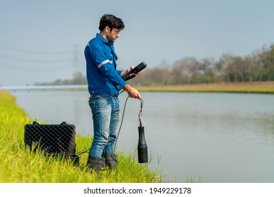 A technician use the Professional Water Testing equipment to measure the water quality at the public canal