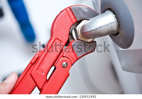 Technician using a wrench to tighten a fitting