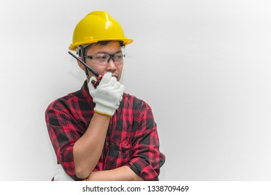 Technician wear helmet with Wrench in hand isolate on white background,Thailand people,Labor day concept,This has clipping path