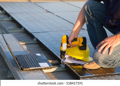 technician while working on a roof for a photovoltaic plant