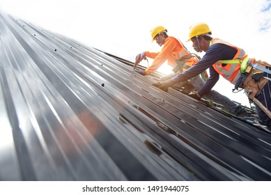 Technician is Work Roof Repair Construction engineer wear safety uniform inspection metal roofing work for roof