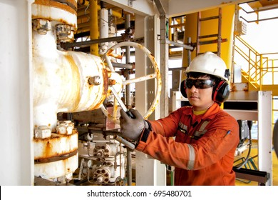 Technician or worker on the job calibrate or function check pneumatic control valve in process oil and gas platform offshore,technician
