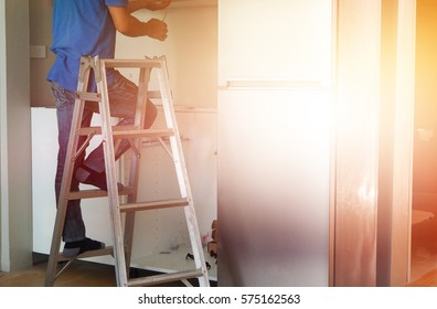 Technician Worker Working on Ladder with Flair