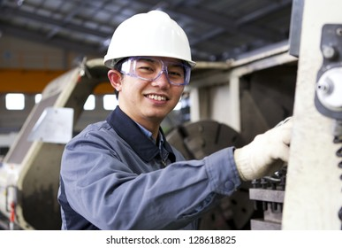 Technician working in factory front of milling cutting machine