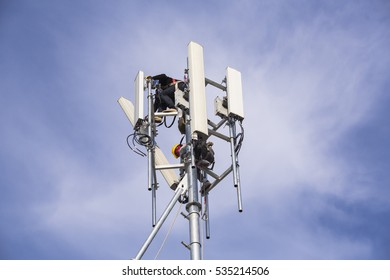 Technician working on communication towers background is blue sky and white soft cloud