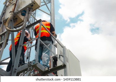 technician working on high telecommunication tower,Engineer wear Personal Protection Equipment for working high risk work,inspect and maintenance equipment on high tower.Team technician repair machine