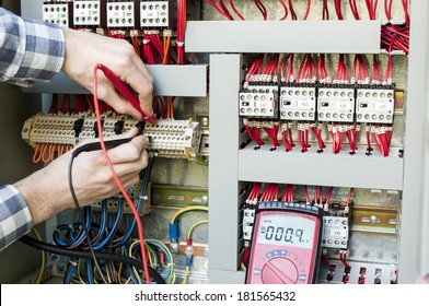 Technician working on industrial panel