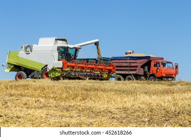 Technician works in the field for the harvest equipment for harvesting